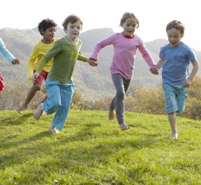 Group of children running together